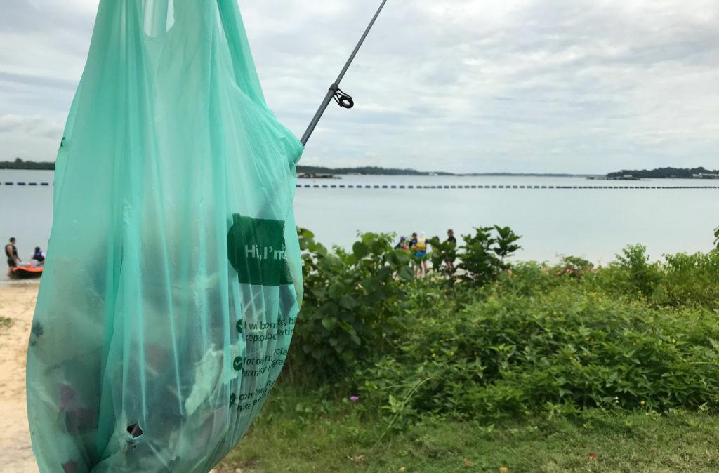 a plastic bag full of trash at the beach Pasir Ris in Singapore