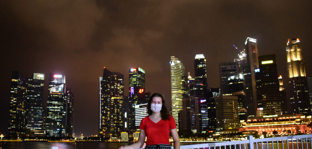 Milena wearing a mask as COVID measure in front of the Central Business District of Singapore