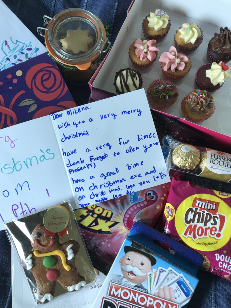 Cupcakes, a monopoly card game, gingerbread, biscuits, chocolate, a few other little things and a card is what I got for Christmas from my buddy family