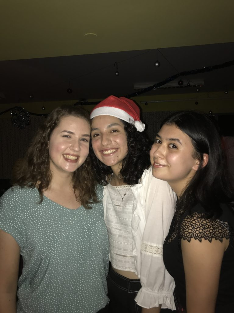 Milena with two friends, happy