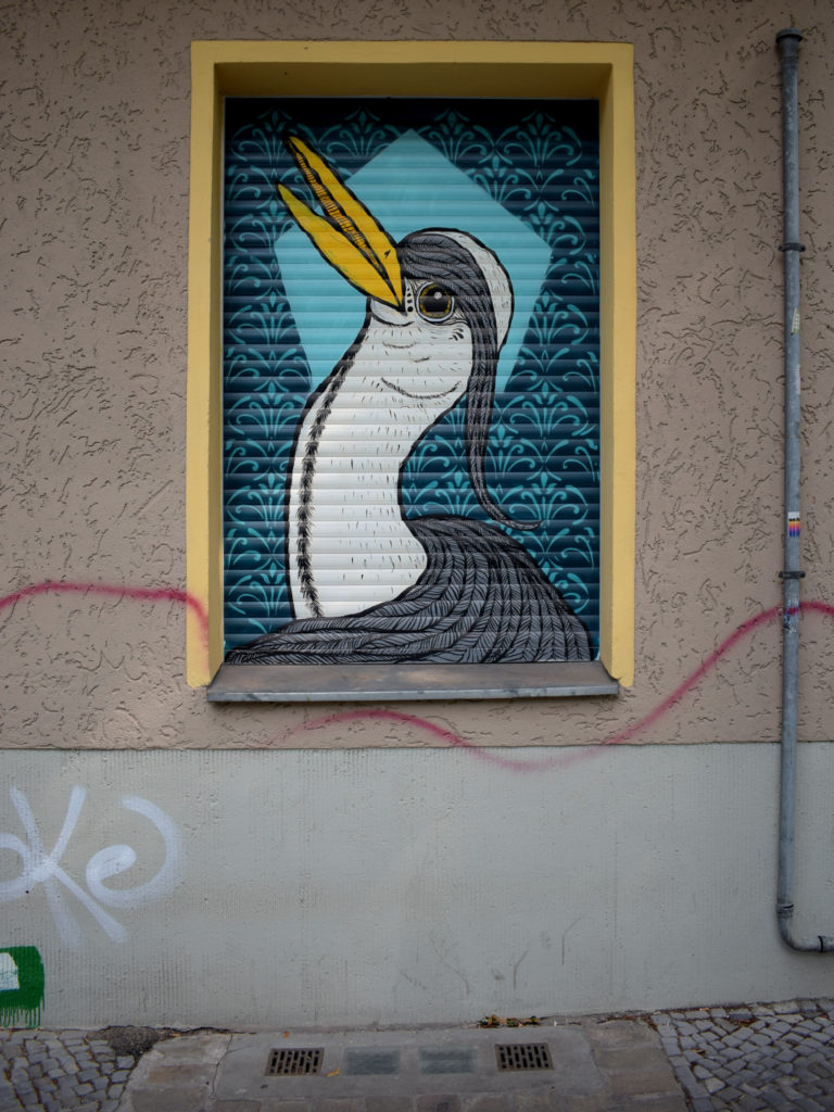 Bird Graffiti at house wall in Berlin